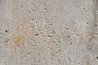 Grunge uneven concrete background texture with rust