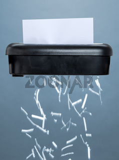 A shredder destroying a document