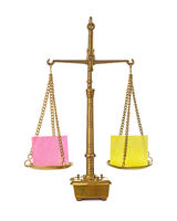 Golden weight balance scale with blank paper