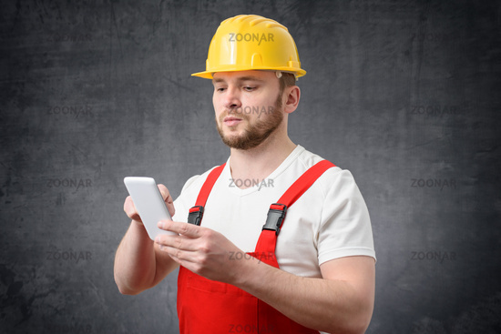 Construction worker using smartphone