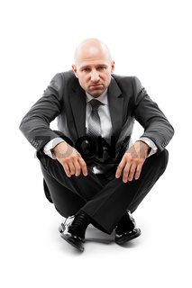 Tired or stressed businessman in depression sitting floor white isolated