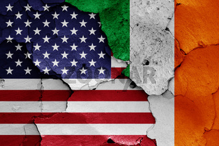 flags of USA and Ireland painted on cracked wall