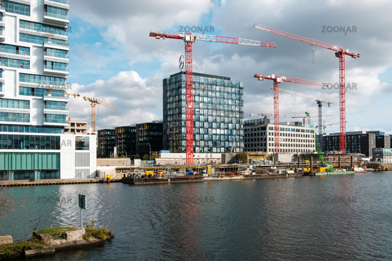 Building construction site at river Spree next to the Berlin wall / East side Gallery