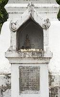 Small shrine holding a Buddha figure, Temple Wat Nong Sikhounmuang, Luang Prabang, Laos