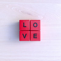 Lettered red blocks forming the word