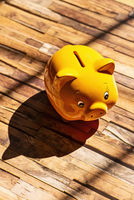 Yellow piggy bank with shadow