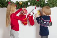 Children opens Christmas stocking