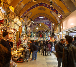 Istanbul, Turkey, 25 March 2019: Grand Bazaar in Istanbul, Turkey, one of the largest and oldest covered markets in the world. Tourists shopping in the Grand Bazaar. Interior view of the Grand Bazaar