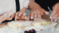 Female hands forms homemade pancakes from cottage cheese