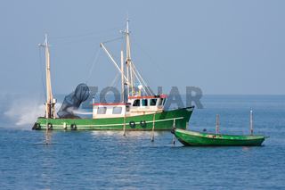 Fishing ship cleaning the nets