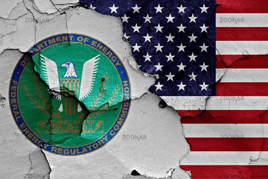 flags of Federal Energy Regulatory Commission and USA painted on cracked wall