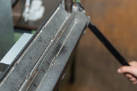 galvanized sheet metal is bent using a bending machine - closeup metalworking