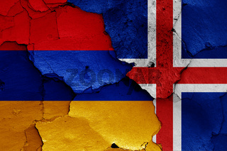 flags of Armenia and Iceland painted on cracked wall
