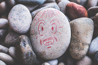 victim of distress attack panic crisis face in trouble ache and despair expression stone draw