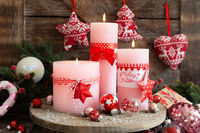 Burning candles and Christmas decorations