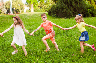 Happy children playing outdoors on a camping holiday
