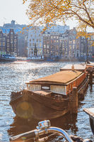 Old boat on a canal in Amsterdam