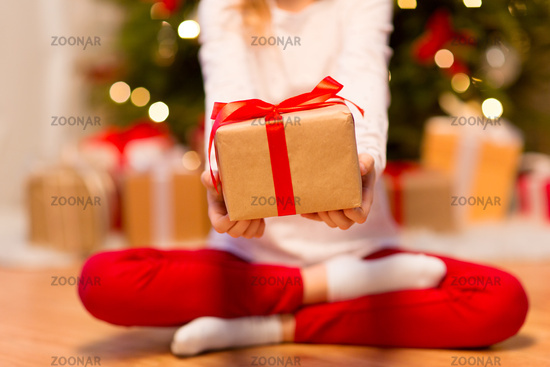 close up of girl with christmas gift at home