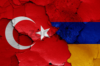 flags of Turkey and Armenia painted on cracked wall