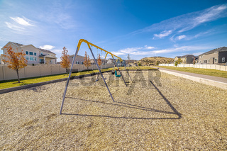 Set of A-frame kids swings in a residential park