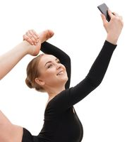 Gymnast performing and taking photo on phone