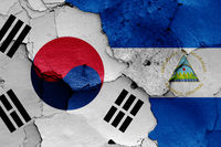 flags of South Korea and Nicaragua painted on cracked wall