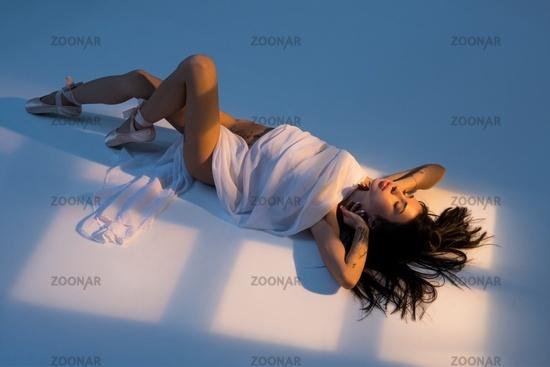 Beautiful female lying on floor