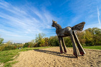 Sculpture of a wooden horse in the nature park of the Marzahn-Hellersorf district.