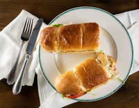 Flat lay of crusty BLT sandwich take out food arranged on plate