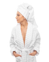Young woman in a bathrobe and towel on her head
