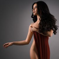 Gorgeous sexy longhaired brunette studio shot