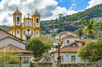 Cityscape of Ouro Preto city with church and hills