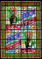 Stained glass window with colorful depiction of the famous Bénédictine liqueur in the Palais Bénédic