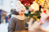 happy little girl at christmas market in winter