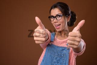 Portrait of beautiful multi ethnic nerd woman with eyeglasses