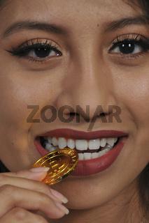 Woman biting Bitcoin
