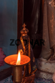 Image of our lady appeared on an altar lit by a candle