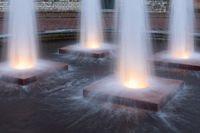 Four illuminated fountains in medieval city Middelburg, The Netherlands