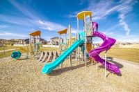 Colorful blue and purple slides in kids playground