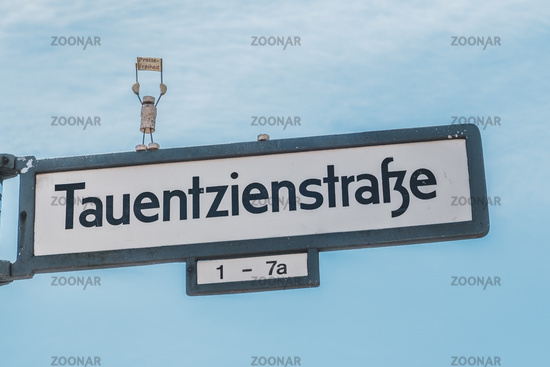 Street sign of the Tauentzienstrasse, with miniature model protesting for freeedom of the press (german: Pressefreiheit)