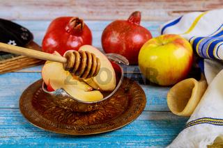 Orthodox Jewish holiday honey on the pomegranate and apples. Jewish new year Rosh Ha Shana shofar