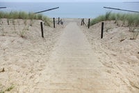 Wooden path across the sand dune to the sandy beach