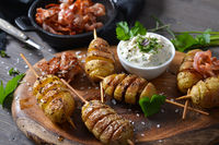 Baked potato spirals with herb curd and bacon