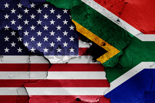 flags of USA and South Africa painted on cracked wall