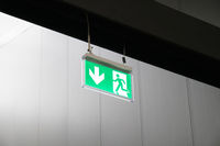 emergency exit or fire escape sign with running man symbol and arrow
