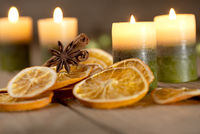 Christmas decoration with candles and spices - fourth Sunday of Advent