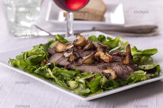 grilled steak on lamb's lettuce