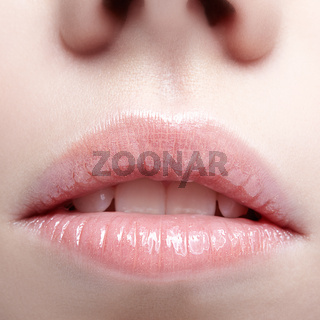 Closeup shot of human female face. Woman with pink plump lips makeup