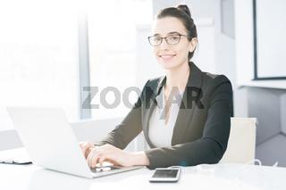 Successful  Businesswoman Posing at Desk