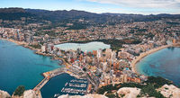 Aerial drone picturesque view from above Calp cityscape salt lake, bay of Mediterranean Sea the both sides photo taken from Penon de Ifach rock. Province of Alicante, Costa Blanca, Spain